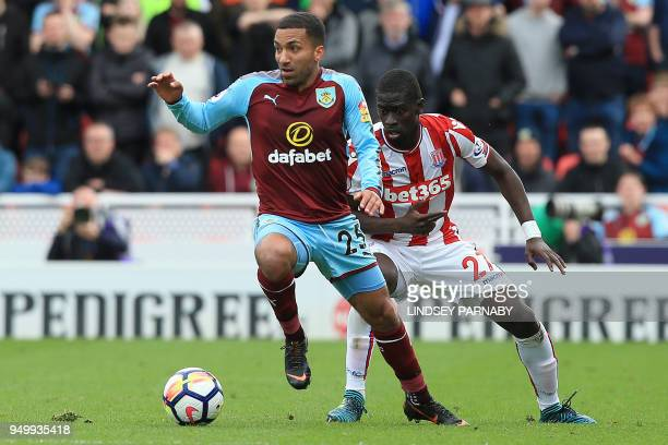 Stoke City's Senegalese defender Badou Ndiaye vies with Burnley's English midfielder Aaron Lennon during the English Premier League football match...