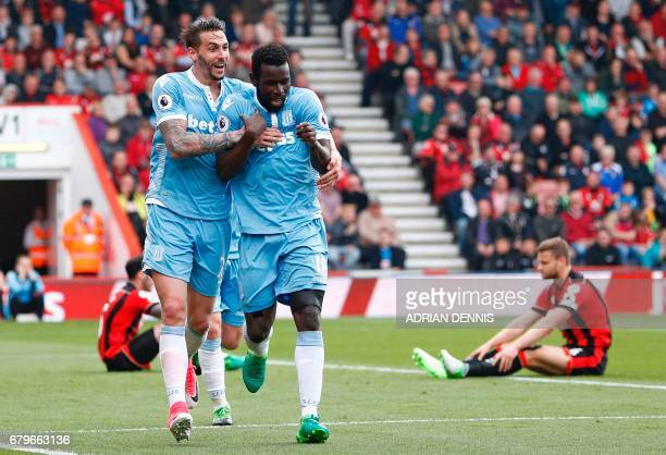 Stoke City's Senegalese striker Mame Biram Diouf celebrates scoring his team's second goal during the English Premier League football match between...