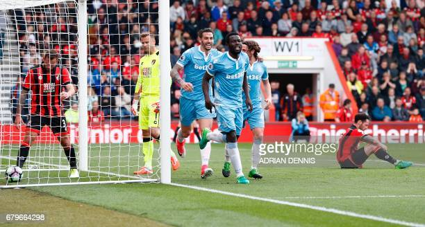 Stoke City's Senegalese striker Mame Biram Diouf celebrates scoring his team's second goal with Stoke City's US defender Geoff Cameron during the...