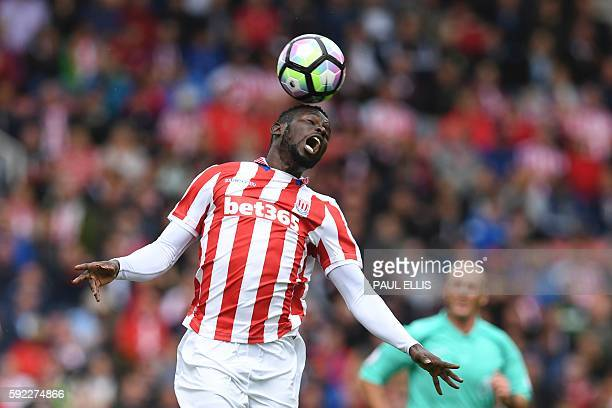 Stoke City's Senegalese striker Mame Biram Diouf heads the ball during the English Premier League football match between Stoke City and Manchester...