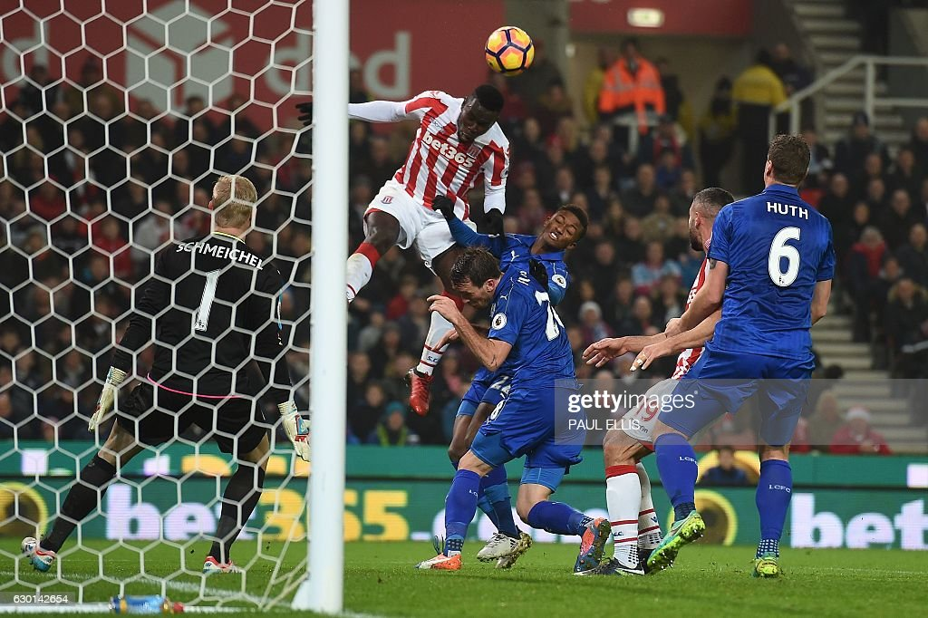 Stoke City's Senegalese striker Mame Biram Diouf jumps to head the ball towards goal but fails to score during the English Premier League football match between Stoke City and Leicester City at the Bet365 Stadium in Stoke-on-Trent, central England on December 17, 2016. The match ended in a draw at 2-2. / AFP / Paul ELLIS / RESTRICTED TO EDITORIAL USE. No use with unauthorized audio, video, data, fixture lists, club/league logos or 'live' services. Online in-match use limited to 75 images, no video emulation. No use in betting, games or single club/league/player publications. /