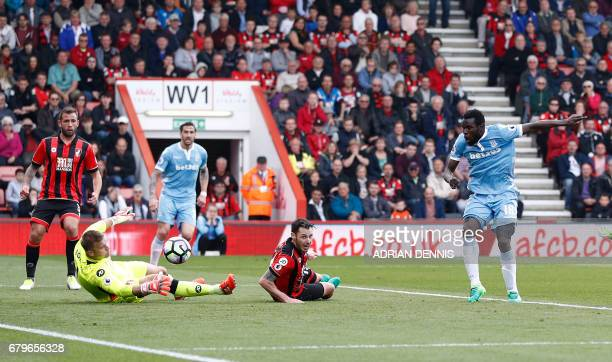 Stoke City's Senegalese striker Mame Biram Diouf scores his team's second goal during the English Premier League football match between Bournemouth...