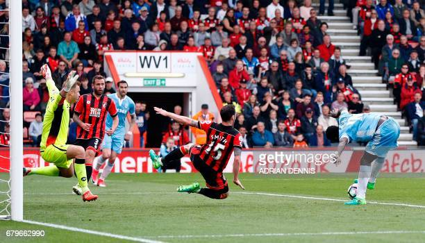 Stoke City's Senegalese striker Mame Biram Diouf shoots to score his team's second goal during the English Premier League football match between...
