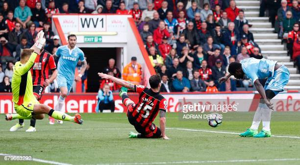 Stoke City's Senegalese striker Mame Biram Diouf shoots to scores his team's second goal during the English Premier League football match between...