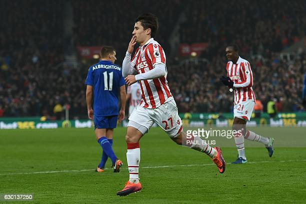 Stoke City's Spanish striker Bojan Krkic celebrates scoring his team's first goal from the penalty spot during the English Premier League football...