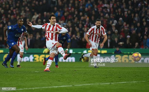 Stoke City's Spanish striker Bojan Krkic shoots from the penalty spot to score his team's first goal during the English Premier League football match...