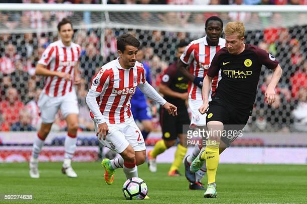 Stoke City's Spanish striker Bojan Krkic vies with Manchester City's Belgian midfielder Kevin De Bruyne during the English Premier League football...