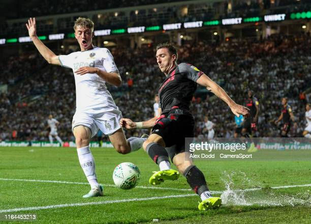 Stoke City's Stephen Ward clears under pressure from Leeds United's Jack Clarke during the Carabao Cup Second Round match between Leeds United and...