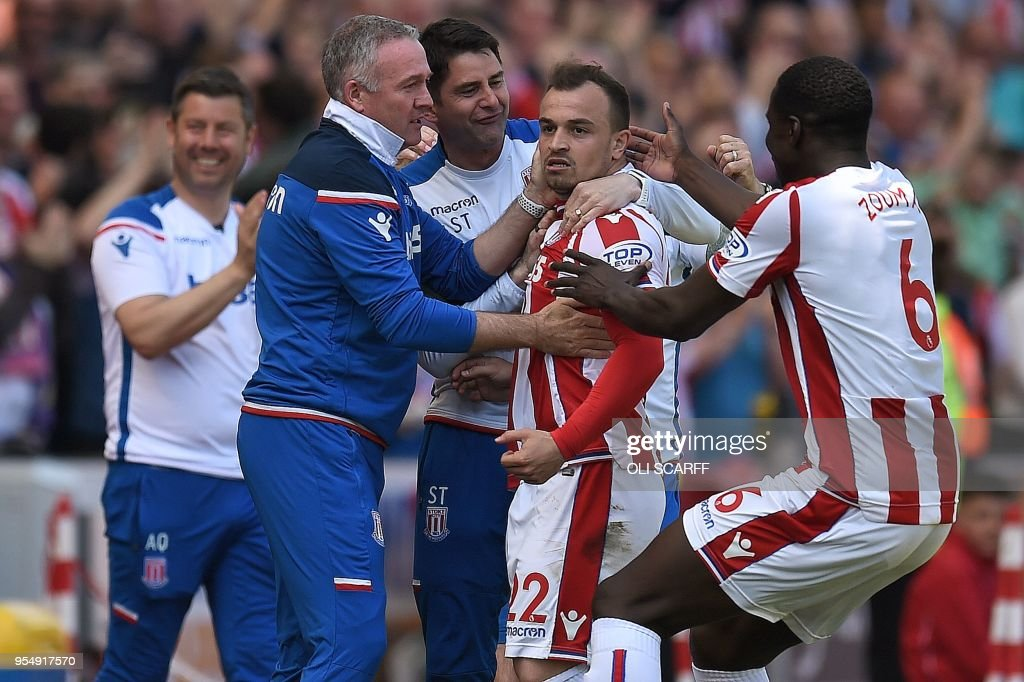 Stoke City's Swiss forward Xherdan Shaqiri (2R) celebrates scoring the opening goal with Stoke City's French defender Kurt Zouma (R) and Stoke City's Scottish manager Paul Lambert (2L) during the English Premier League football match between Stoke City and Crystal Palace at the Bet365 Stadium in Stoke-on-Trent, central England on May 5, 2018. (Photo by Oli SCARFF / AFP) / RESTRICTED TO EDITORIAL USE. No use with unauthorized audio, video, data, fixture lists, club/league logos or 'live' services. Online in-match use limited to 75 images, no video emulation. No use in betting, games or single club/league/player publications. /