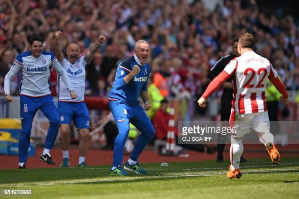 Stoke City's Swiss forward Xherdan Shaqiri celebrates scoring the opening goal with Stoke City's Scottish manager Paul Lambert during the English...