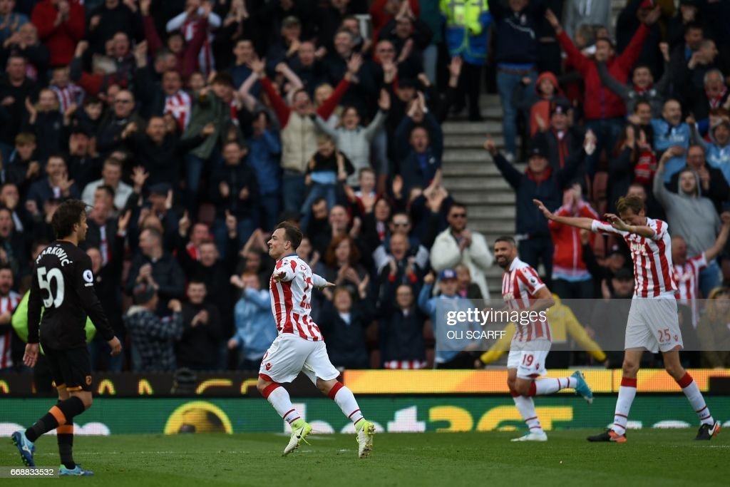 Stoke City's Swiss forward Xherdan Shaqiri (2L) celebrates scoring their third goal during the English Premier League football match between Stoke City and Hull City at the Bet365 Stadium in Stoke-on-Trent, central England on April 15, 2017. / AFP PHOTO / Oli SCARFF / RESTRICTED TO EDITORIAL USE. No use with unauthorized audio, video, data, fixture lists, club/league logos or 'live' services. Online in-match use limited to 75 images, no video emulation. No use in betting, games or single club/league/player publications. /