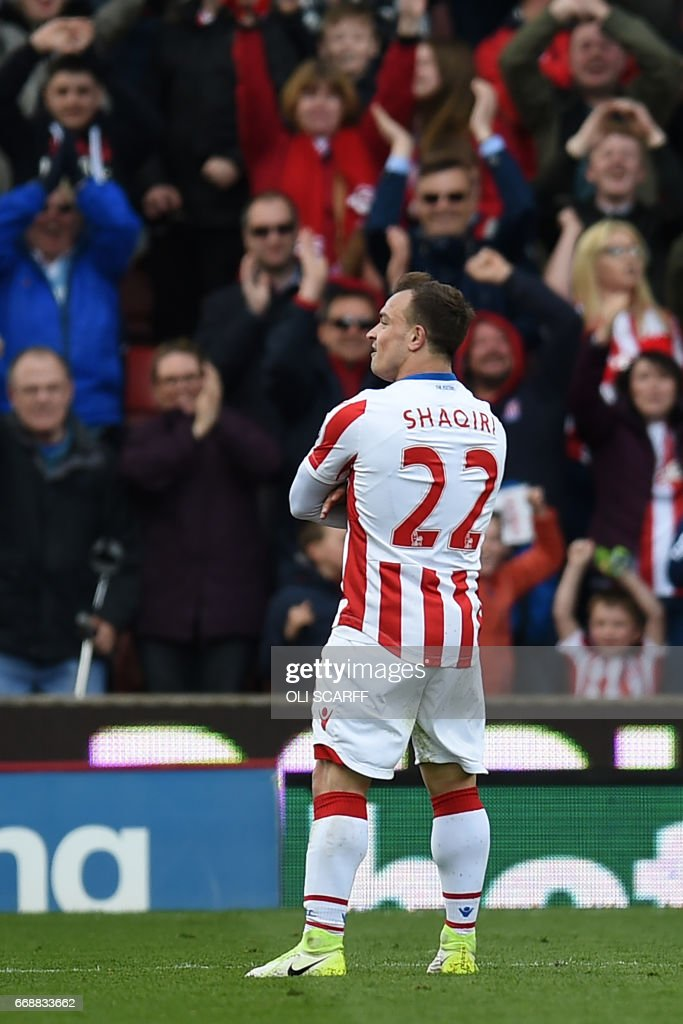 Stoke City's Swiss forward Xherdan Shaqiri celebrates scoring their third goal during the English Premier League football match between Stoke City and Hull City at the Bet365 Stadium in Stoke-on-Trent, central England on April 15, 2017. / AFP PHOTO / Oli SCARFF / RESTRICTED TO EDITORIAL USE. No use with unauthorized audio, video, data, fixture lists, club/league logos or 'live' services. Online in-match use limited to 75 images, no video emulation. No use in betting, games or single club/league/player publications. /