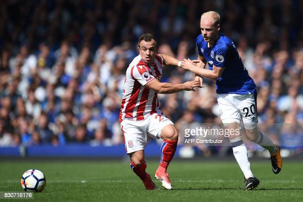 Stoke City's Swiss forward Xherdan Shaqiri vies with Everton's Dutch midfielder Davy Klaassen during the English Premier League football match...