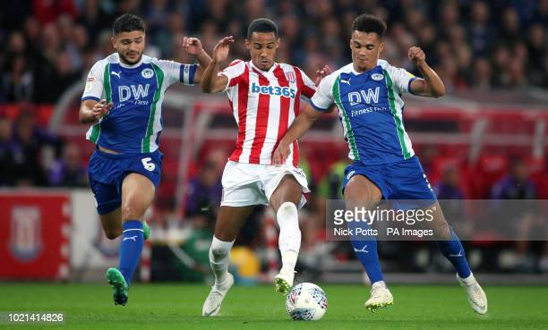 Stoke City's Tom Ince battles with Wigan Athletic's Sam Morsy and Antonee Robinson during the Sky Bet Championship match at the bet365 Stadium Stoke