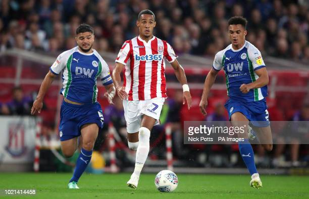 Stoke City's Tom Ince gets away from Wigan Athletic's Sam Morsy and Antonee Robinson during the Sky Bet Championship match at the bet365 Stadium Stoke