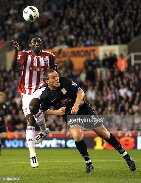 Stoke City's Trinidadian forward Kenwyne Jones vies with Aston Villa's Irish defender Richard Dunne during the English Premier League football match...