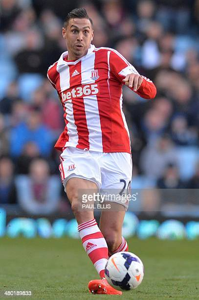 Stoke City's US defender Geoff Cameron passes the ball during the English Premier League football match between Aston Villa and Stoke City at Villa...