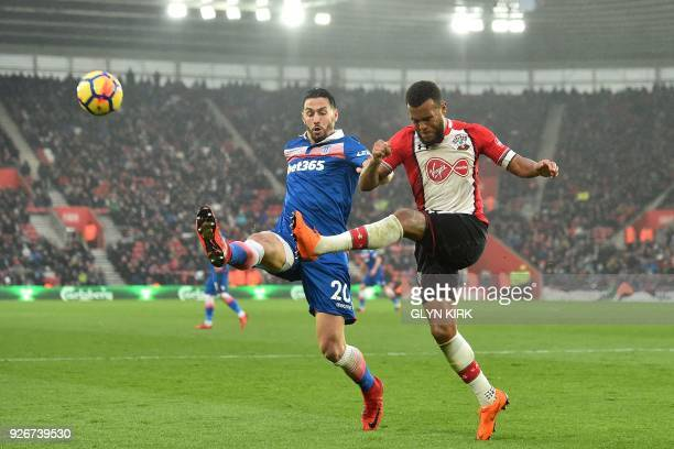 Stoke City's US defender Geoff Cameron vies with Southampton's English defender Ryan Bertrand during the English Premier League football match...