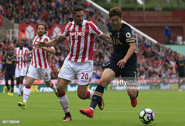 Stoke City's US defender Geoff Cameron vies with Tottenham Hotspur's South Korean striker Son HeungMin during the English Premier League football...