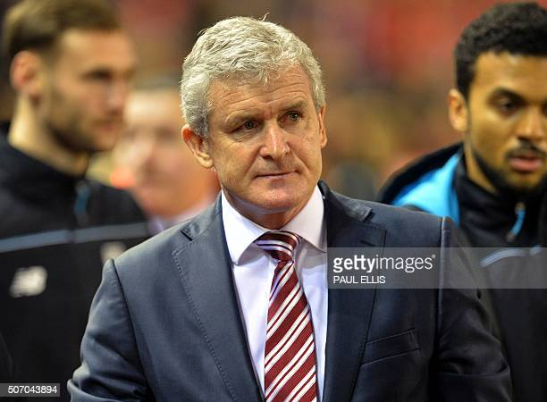 Stoke City's Welsh manager Mark Hughes arrives for the English League Cup semifinal second leg football match between Liverpool and Stoke City at...