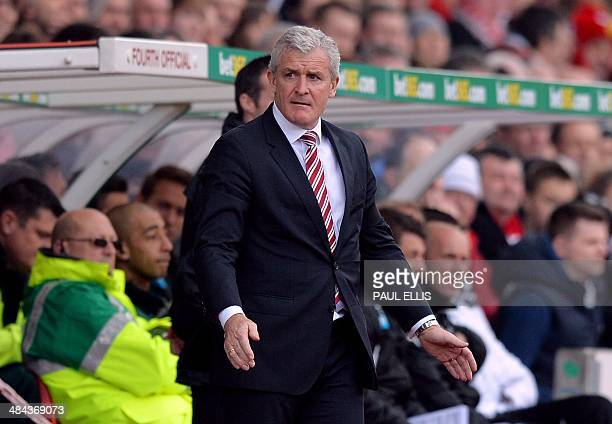 Stoke City's Welsh manager Mark Hughes attends the English Premier League football match between Stoke City and Newcastle United at the Britannia...