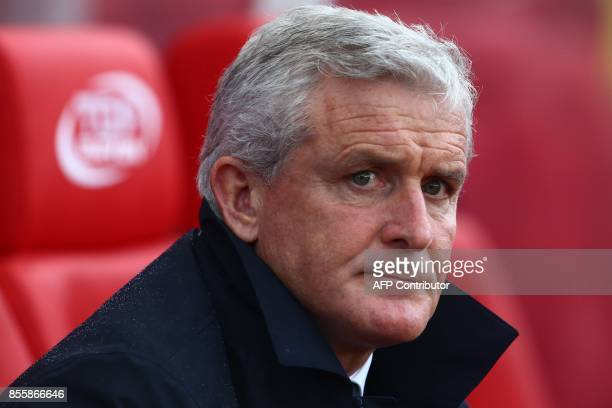 Stoke City's Welsh manager Mark Hughes awaits kick off in the English Premier League football match between Stoke City and Southampton at the Bet365...
