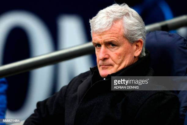 Stoke City's Welsh manager Mark Hughes awaits kick off in the English Premier League football match between Tottenham Hotspur and Stoke City at...