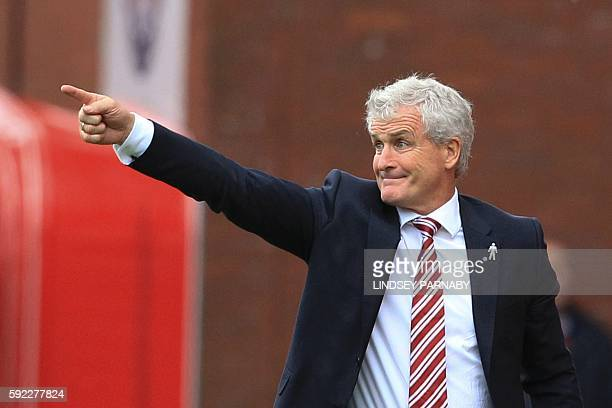 Stoke City's Welsh manager Mark Hughes gestures from the touchline during the English Premier League football match between Stoke City and Manchester...