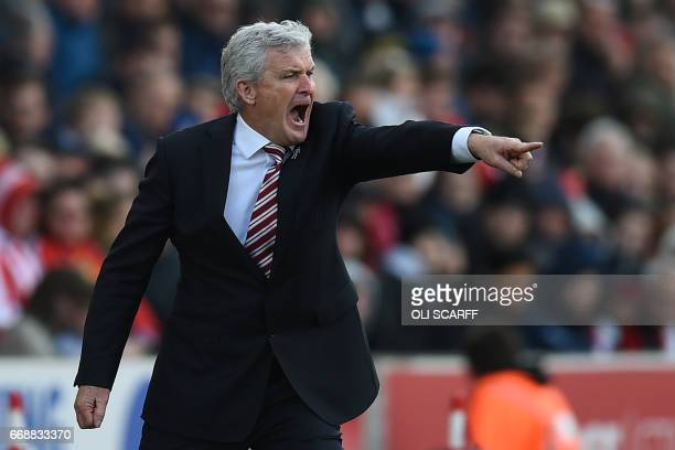 Stoke City's Welsh manager Mark Hughes gestures on the touchline during the English Premier League football match between Stoke City and Hull City at...
