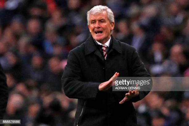 Stoke City's Welsh manager Mark Hughes gestures on the touchline during the English Premier League football match between Tottenham Hotspur and Stoke...