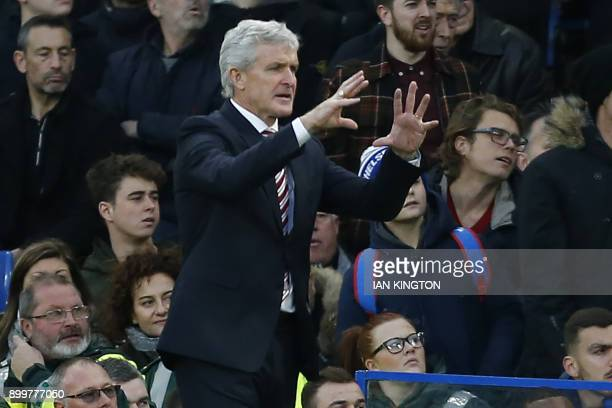 Stoke City's Welsh manager Mark Hughes gestures on the touchline during the English Premier League football match between Chelsea and Stoke City at...