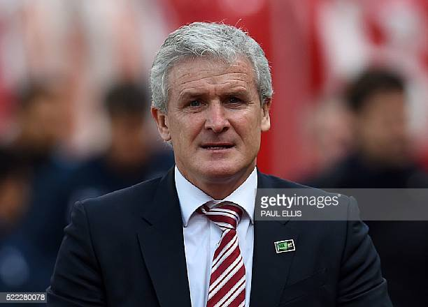 Stoke City's Welsh manager Mark Hughes is pictured before the start of the English Premier League football match between Stoke City and Tottenham...