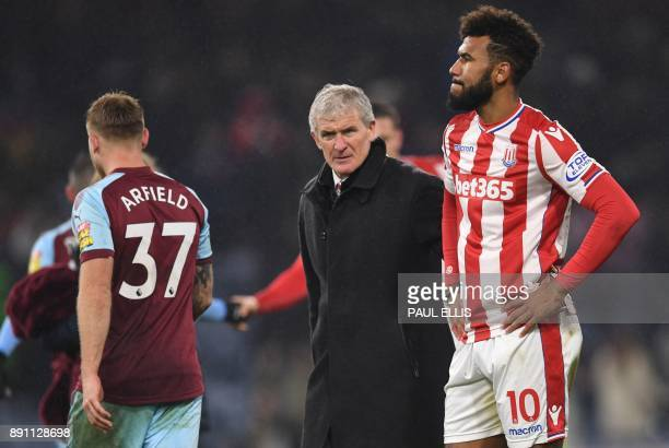 Stoke City's Welsh manager Mark Hughes leaves the pitch after losing the English Premier League football match between Burnley and Stoke at Turf Moor...