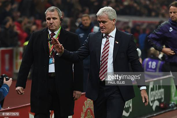 Stoke City's Welsh manager Mark Hughes leaves the pitch after winning the English Premier League football match between Stoke City and Swansea at the...