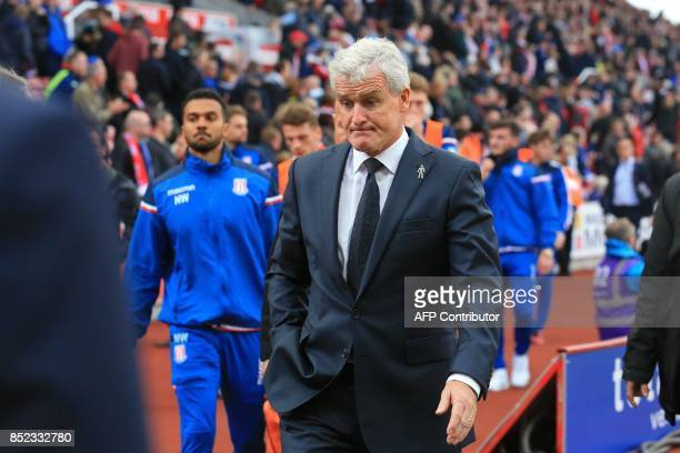 Stoke City's Welsh manager Mark Hughes reacts as he leaves the touchline during the English Premier League football match between Stoke City and...