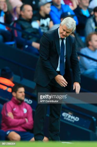 Stoke City's Welsh manager Mark Hughes reacts on the touchline during the English Premier League football match between Manchester City and Stoke...