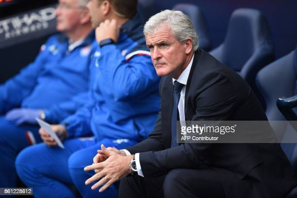 Stoke City's Welsh manager Mark Hughes waits for kick off of the English Premier League football match between Manchester City and Stoke City at the...