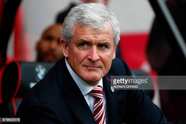 Stoke City's Welsh manager Mark Hughes watches ahead of the English Premier League football match between Bournemouth and Stoke City at the Vitality...