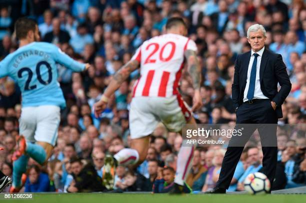 Stoke City's Welsh manager Mark Hughes watches from the touchline during the English Premier League football match between Manchester City and Stoke...