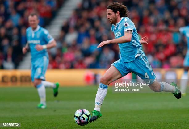 Stoke City's Welsh midfielder Joe Allen runs with the ball during the English Premier League football match between Bournemouth and Stoke City at the...