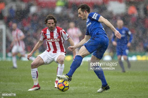 Stoke City's Welsh midfielder Joe Allen vies with Everton's English defender Leighton Baines during the English Premier League football match between...