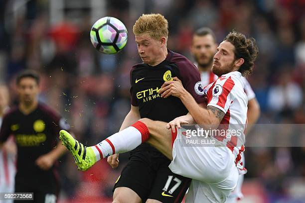 Stoke City's Welsh midfielder Joe Allen vies with Manchester City's Belgian midfielder Kevin De Bruyne during the English Premier League football...