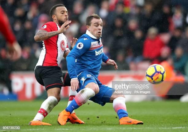 Stoke City's Xherdan Shaqiri and Southampton's Ryan Bertrand battle for the ball during the Premier League match at St Mary's Stadium Southampton