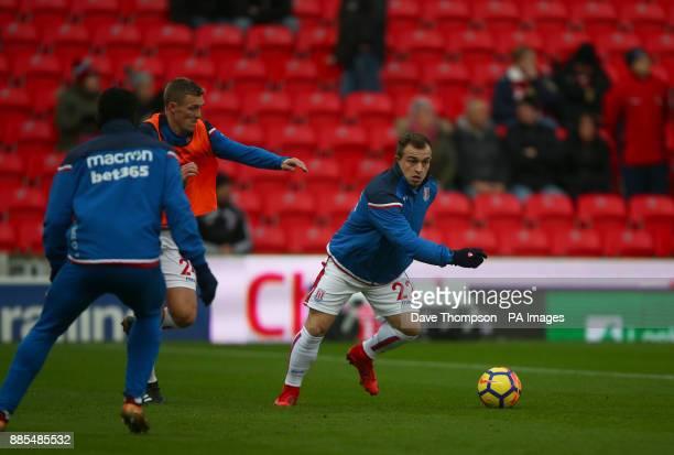 Stoke City's Xherdan Shaqiri and Stoke City's Darren Fletcher during the Premier League match at the Bet35 Stadium StokeonTrent