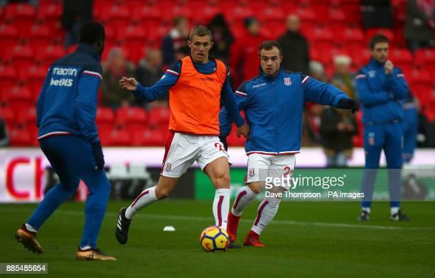 Stoke City's Xherdan Shaqiri and Stoke Citys Darren Fletcher during the Premier League match at the Bet35 Stadium StokeonTrent