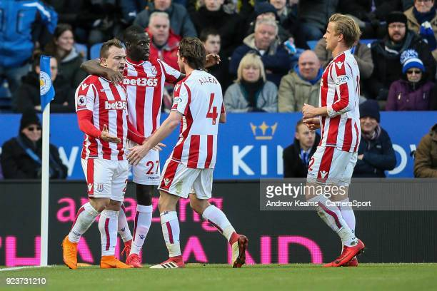 Stoke City's Xherdan Shaqiri celebrates with his team mates after scoring his side's first goal during the Premier League match between Leicester...