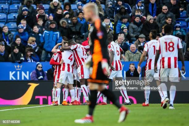 Stoke City's Xherdan Shaqiri celebrates with his team mates after scoring their first goal as Leicester City's goalkeeper Kasper Schmeichel walks...