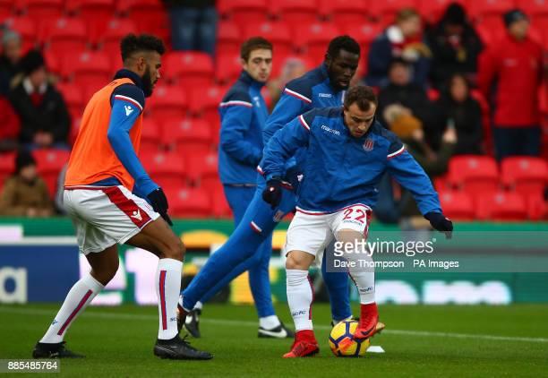 Stoke City's Xherdan Shaqiri Stoke City's Eric Maxim ChoupoMoting left and Stoke City's Mame Biram Diouf warm up during the Premier League match at...
