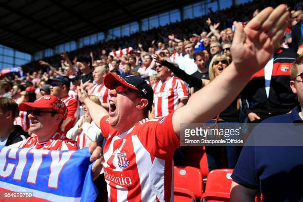 Stoke fans cheer on their side during the Premier League match between Stoke City and Crystal Palace at the Bet365 Stadium on May 5 2018 in...