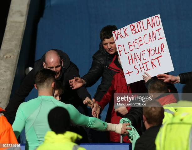 Stoke goalkeeper Jack Butland gives his shirt to an appreciative fan despite making a mistake that led to the Leicester equalising goal during the...